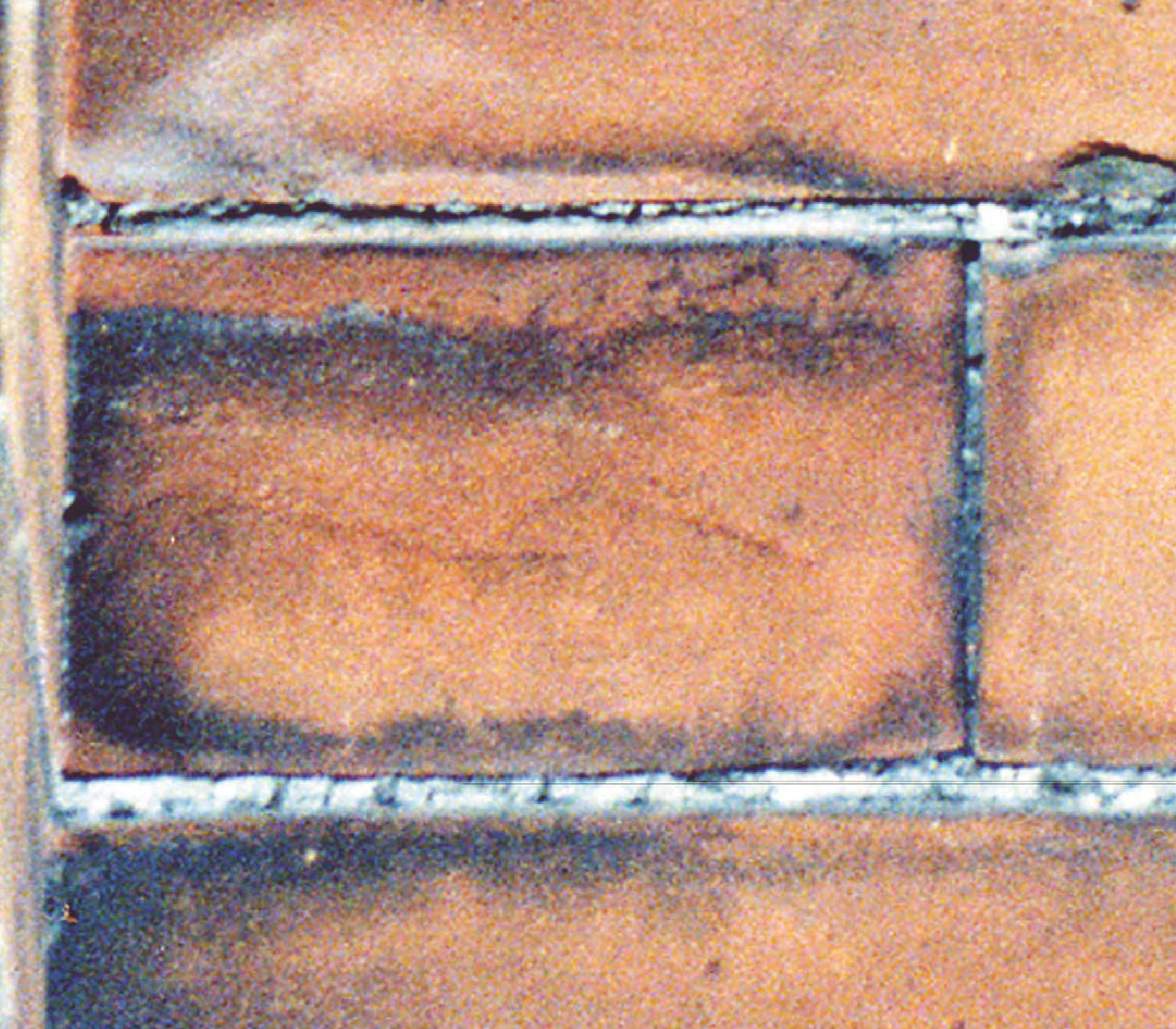 Typical soiling ring on brick face note white deposits in for Soil your pants